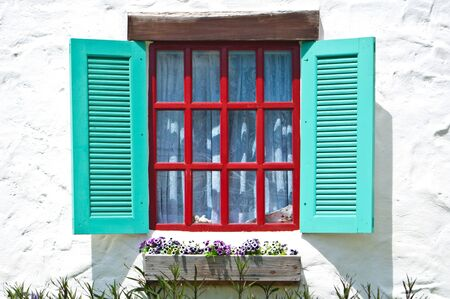 pane: Old window on white wall of vintage house style