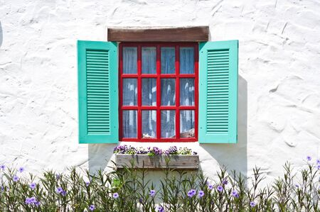 Colorful window on white wall  photo