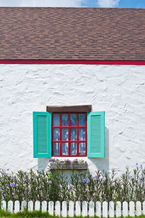 Bueatiful window on white wall of vintage house style photo