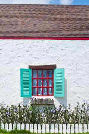 pane: Bueatiful window on white wall of vintage house style