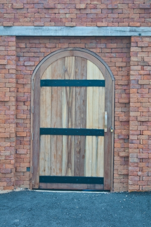 Old wooden door in a blick wall  photo
