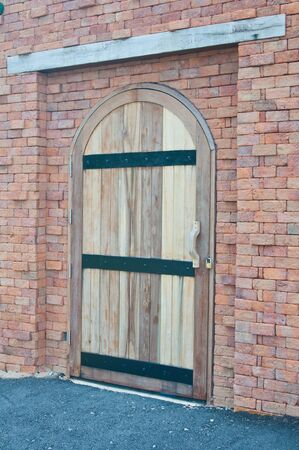 Old Wooden Door on Grunge Old Brick Wall  photo