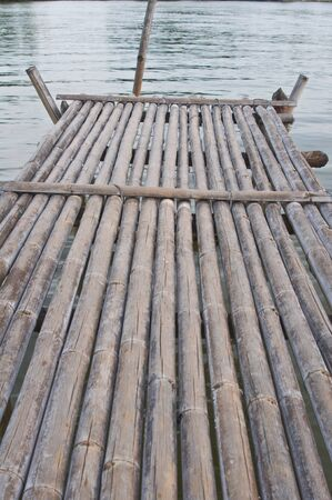 Ancient bamboo wooden bridge photo