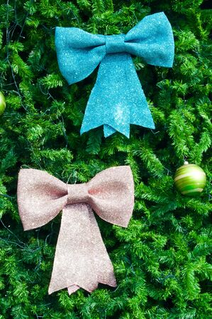 Blue and pink bow on christmas tree photo