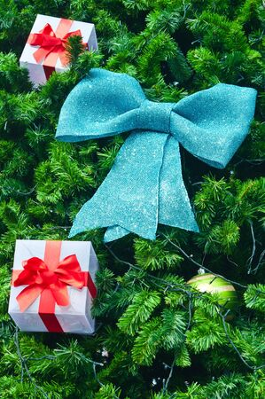 Blue bow and gift on the christmas tree photo