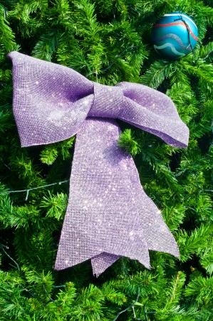 Purple big bow and blue ball on christmas tree Stock Photo - 16468293