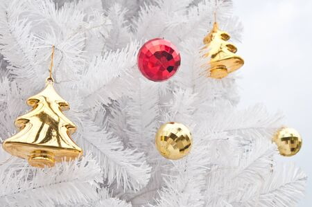 artificial lights: Gift and toys on white christmas tree