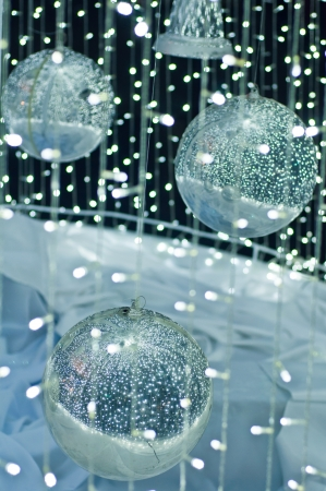 Sparkle of silver balls and white fabric photo