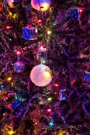 Crystal ball on christmas tree with lighting photo