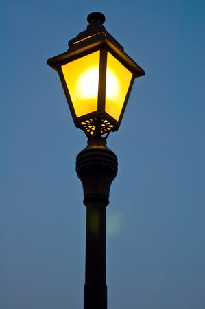 Old street lamp in the evening photo