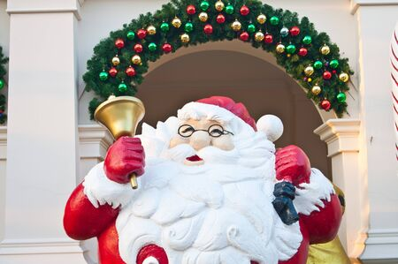Santa clause with golden bell on hand photo