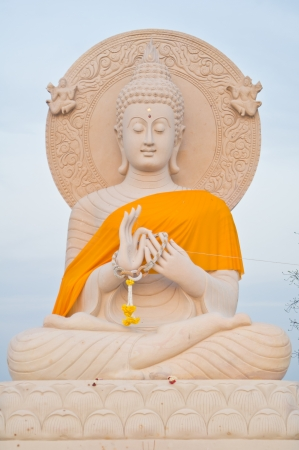 Giant  sandstone buddha statue photo