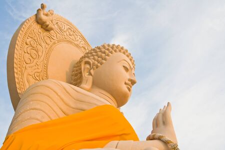 Big stone buddha statue against in the blue sky  photo