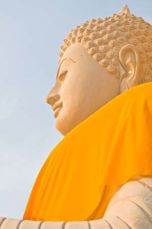 Face of big sandstone buddha statue photo