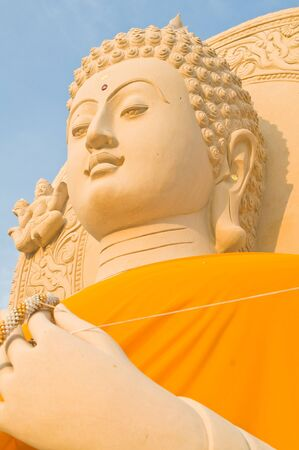 Sandstone buddha statue with sunlight  photo