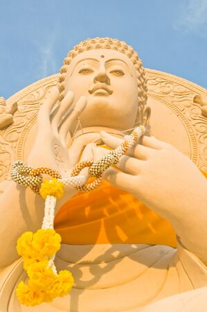 Buddha statue againt in the blue sky background photo