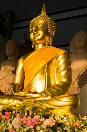 Golden buddha with yellow robe photo