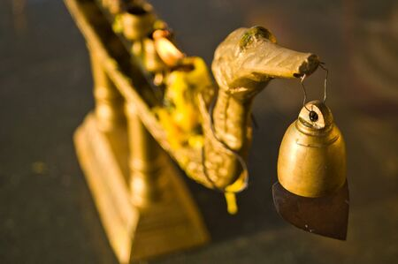 Buddhist bell on the candlestick in thai style photo