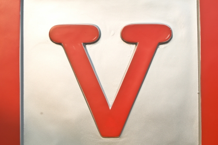 V   wording  in red color photo