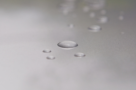 Water droplets on the grey roof of car photo