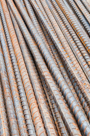 Rust steel rods in construction site photo