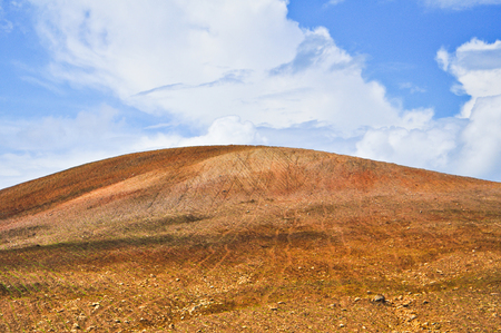 Beautiful brown mountain against blue sky background and wallpaper