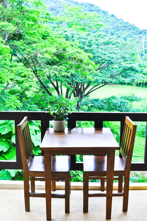 Wooden chair and table on the terrace ,Mountain view photo