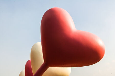 Heart balloon against blue sky photo
