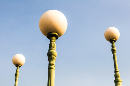 Vintage street light against the blue sky  photo