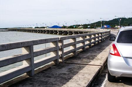cement pole: Car on smooth sea concrete bridge in Thailand