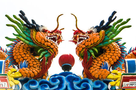 Two dragon on top of the chinese temple photo