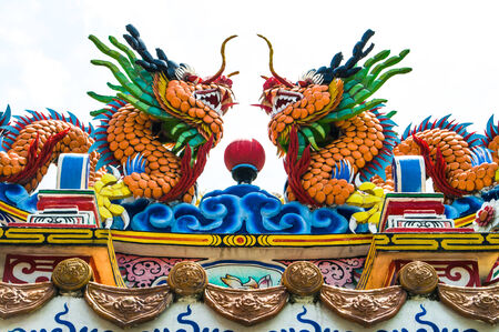 Colorful dragon on top of the chinese temple photo