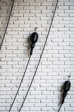 eletrical: Line of eletrical on the white brick wall