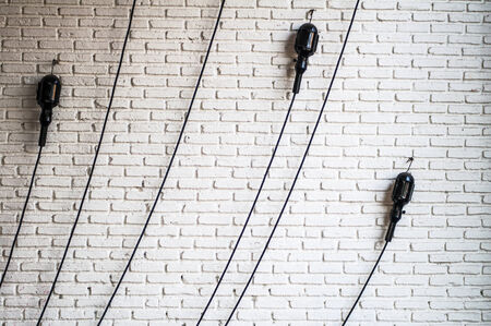 eletrical: Line of eletrical on the brick wall