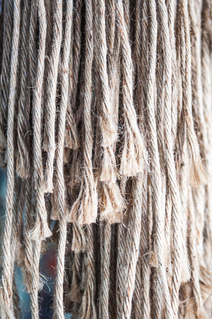 sever: Piece of rope frayed in row