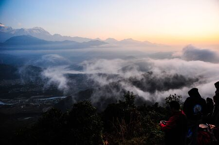 apogee: Morning sunlight and fog on the mountain in PokharaNepa