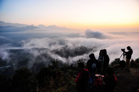 apogee: Morning mist and photographer in PokharaNepal