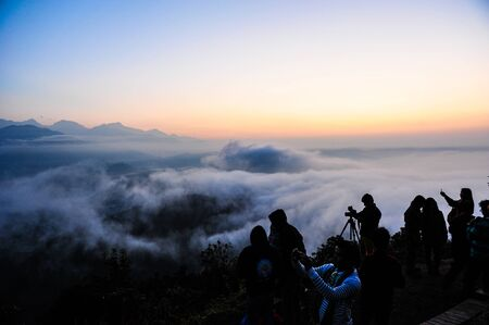 apogee: Morning mist and people in PokharaNepal Stock Photo