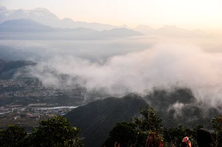 apogee: Morning mist on the mountain and city of PokharaNepal