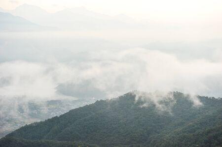 apogee: Morning mist on the mountain in PokharaNepal Stock Photo