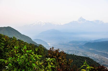 pokhara: Pokhara city in mist and snow mountain backgroundNepal