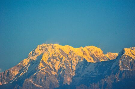 apogee: Morning sunrise on top of the snow mountains in Nepal