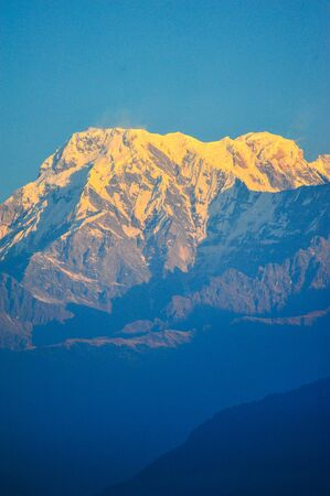 apogee: Orange of sunlight on the mountains of machapuchare in Pokhara,Nepal Stock Photo