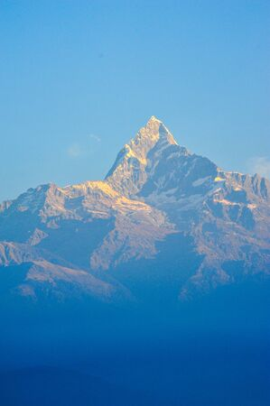 apogee: Orange of sunlight on top of the mountains of machapuchare in Pokhara,Nepal Stock Photo