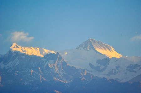 apogee: Orange of sunlight on the mountains peak of machapuchare in Pokhara,Nepal