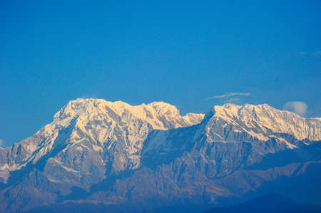apogee: Top of the big snow mountains of machapuchare in Pokhara,Nepal