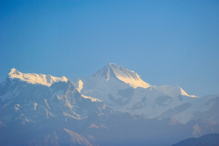 apogee: Sunlight effect on the big mountains against blue sky in Pokhara,Nepal Stock Photo