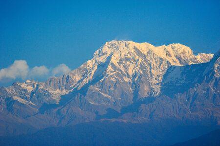 apogee: Big snow mountains against blue sky in Pokhara,Nepal Stock Photo