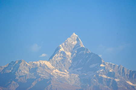 apogee: Sunlight on peak of  the big snow mountains against blue sky in PokharaNepal Stock Photo