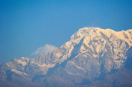 apogee: Big white snow mountains against blue sky in Pokhara,Nepal